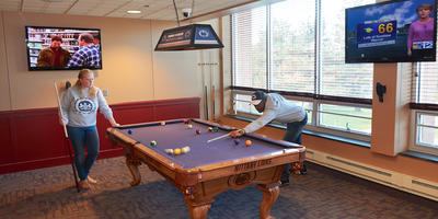 students playing pool in Olivers Game Room