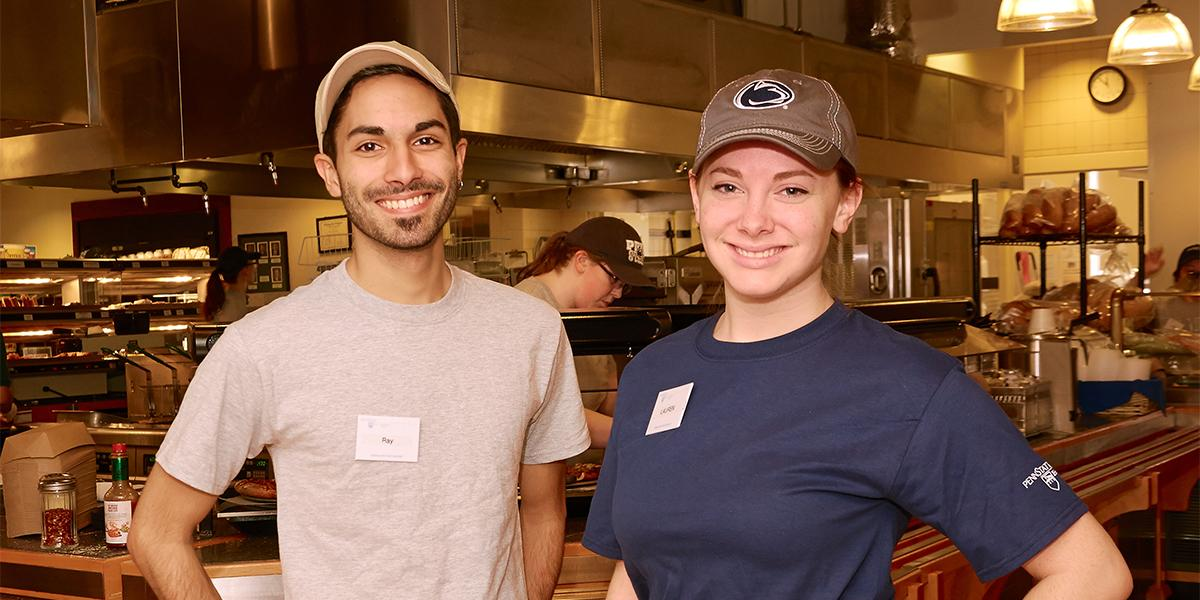 Two student workers smiling